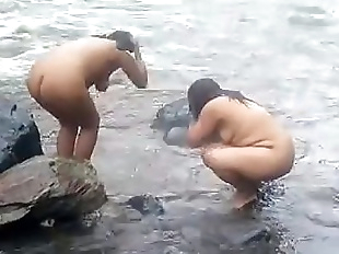 2992477 two indian mature womens bathing in..