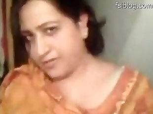 Beautiful Punjabi bhabi shows her boobs, sucks..